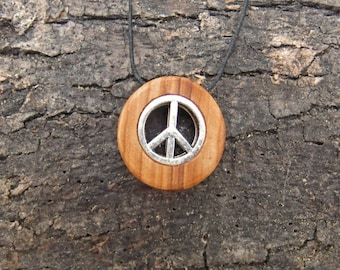 Olive wood pendant with two inlaid peace symbols