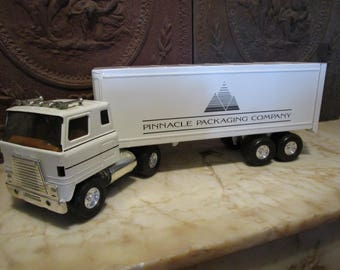 Vintage late 1970s era, 'Pinnacle Packaging Co.' International, cab-over tractor trailer by 'ERTL!