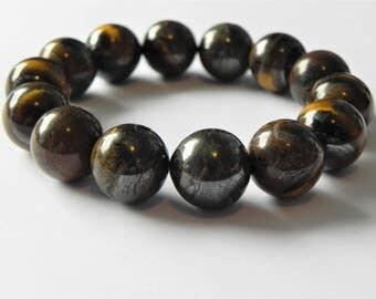Tiger iron stretch gemstone bracelet. Brown, gold, caramel, gun metal grey.