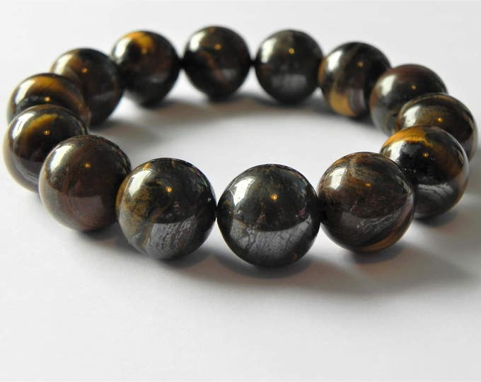 Tiger iron stretch gemstone bracelet. Brown, gold, caramel, gun metal grey.