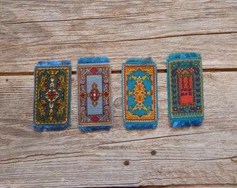Set of four blue tobacco felts carpets, dollhouse rugs, miniature carpets, tobacco premiums, blue miniature rugs