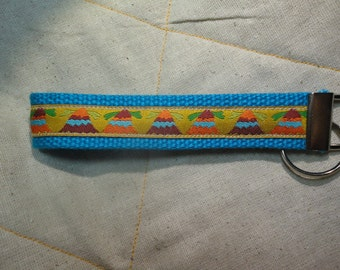 Fun Jacquard Woven Print Ribbon Key Fobs in Mountain tops on blue webbing or bird on blue webbing