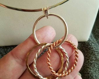 4 rings pendant. Sterling silver, copper and brass.