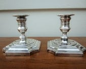 Made in England silver candlesticks by Barker Ellis.