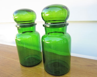 A pair of vibrant green glass canister jars.  Belgium green glass organization canisters.