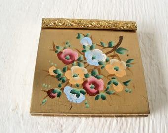 Vintage compact Volupte Swinglok mirror loose powder painted floral gold metal 1960s