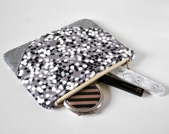 Woman's polka dot spot confetti party print silver glitter linen padded beauty pouch protective black and white make up bag cosmetics pouch.