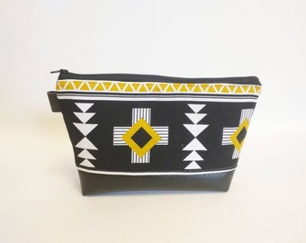 Makeup bag in southwestern Aztec print and black faux leather