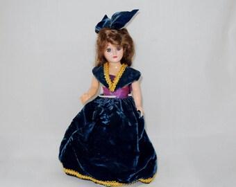 Small Vintage Plastic Doll in a  Velveteen Dress