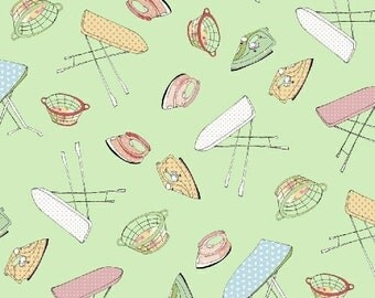 LAUNDRY DAY  cotton print by the yard tossed ironing boards, laundry baskets, irons on green Windham Fabric 42420-5