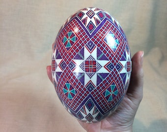 Purple checkerboard and geometric roses rhea pysanka made batik style from real rhea egg shell in Ukrainian tradition