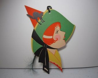 Colorful 1920's-30's unused large die cut Halloween bridge tally profile of pretty witch with a black arched cat on her hat