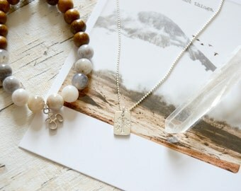Grounded. Sterling Silver Tree Tag Necklace.
