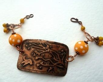 handmade lampwork copper and orange spot bracelet, UK jewellery