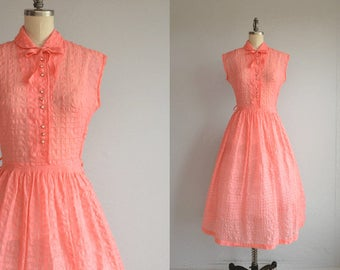 Vintage 50s Dress / 1950s Sheer Coral Pink Seersucker Day Dress / Rhinestone Buttons Bow