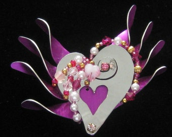 "LIZ TECH  ""Wild Heart"" Brooch in Mirrored Silver Metal with Fuchsia Metal Finish Accents and a Mix of Pink Beaded Accents. Pearl"