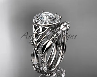 """14kt white gold diamond celtic trinity knot wedding ring, engagement set with a """"Forever One"""" Moissanite center stone CT7328S"""