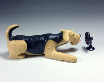 Airedale Terrier Ceramic Dog Sculpture, cooling off in front of the fan