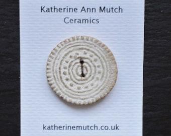 A large handmade ceramic button - dandelion seed head.  Cream white sand.  37mm.