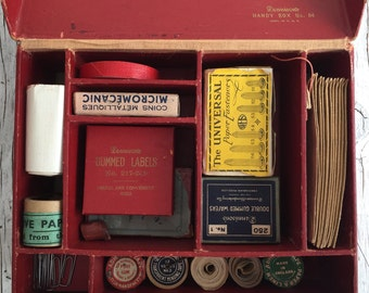 A rare Dennison's Handy Box. Home or office stationery set in a red box with individual compartments and 17 original contents. Made in USA.