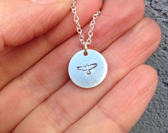 Bird in flight hand stamped pendant necklace