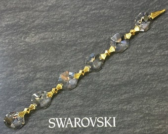 2 Swarovski STRASS Art #8015/8016 14mm CLEAR Octagons with Brass Bowtie Connectors 4 3/4 inches of 1940s STRASS. Vintage and Discontinued