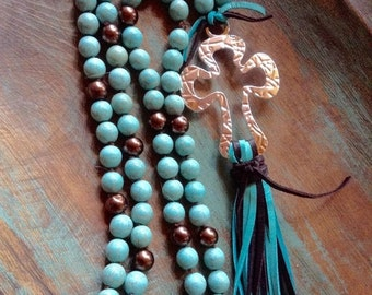 ON SALE Long western knotted turquoise magnesite and brown glass pearl cross and deerskin leather tassel necklace