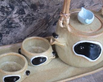 raccoon teapot