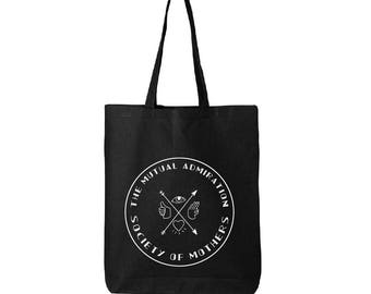 Black Canvas Tote Bag with The Mutual Admiration Society of Mothers design. 15x15 inches.
