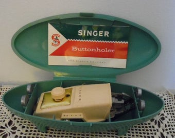 Singer Buttonholer and Templates Model No 489500 or No 489510 makes straight and keyhole buttonholes Dated 1960 in a Turquoise Retro Case