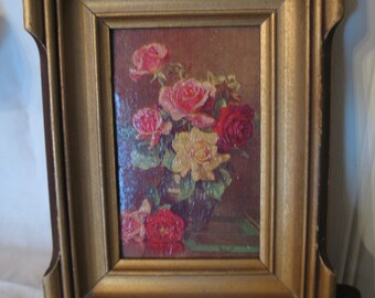 Small wooden frame vintage with flower on cardboard paint.