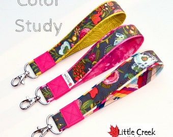 One Gray floral wristlet keychain with three color options finished with a hot pink wrap