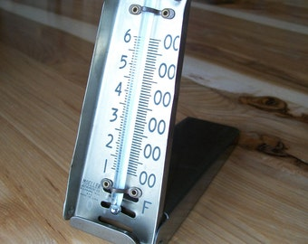 Oven thermometer folds and stands on its own by Moeller Instrument co. Made in USA