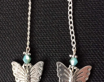Butterfly with turquoise bead fishhook earrings.