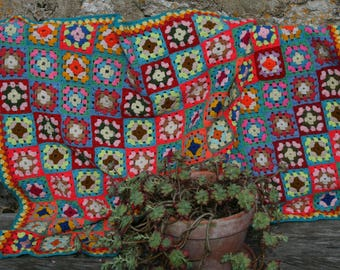 Abidjan:  French vintage crocheted baby blanket made with granny squares, crocheted edge.