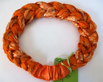 A rich Sari Silk Braided Headband woven of orange sari silk embroidered in gold. Orange you happy you looked!?