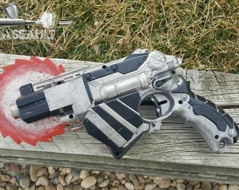 Modified Nerf gun with saw blade