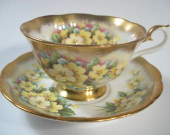 Royal Albert Treasure Chest Series Tea Cup And Saucer, Yellow Primrose and Heavy Brushed Gold Tea cup and Saucer set.