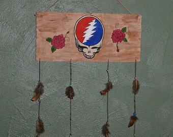Hand painted Stealie on distressed wood with hanging feathers