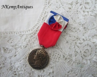 Old french medal with ribbon