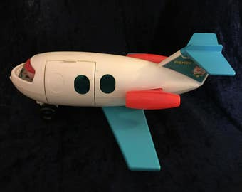 Vintage 1970s Fisher Price Fun Jet Toy Airplane With Pilot  / Teal Wings