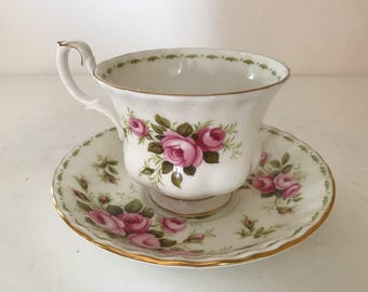 Gorgeous  Royal Albert's Rose Tea Cup and Saucer-June Birthday- Pretty Roses with Gold Trim- Great Condition.