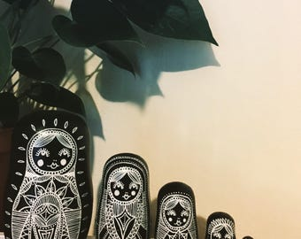 Large black and White Russian doll set.