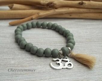 Yoga bracelet wood ohm sign olive green