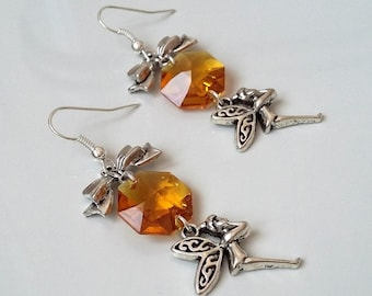 Earrings with fairy and crystal amber color