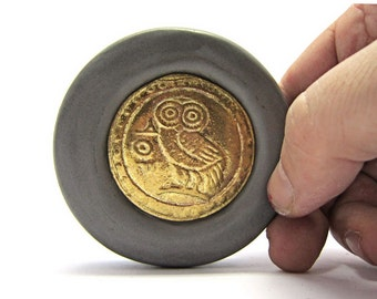Paper weight of brass combined with stone casting . Figure of Glafka the Athenian owl