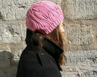 Pink light beret for women. Women's hat with leaf pattern.