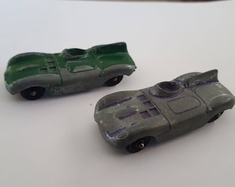 Vintage late 1950's Tootsietoy Jaguar D - Type race car toys, chippy British Racing Green and purple