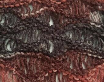 Knit infinity scarf in earthy tones