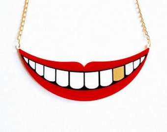 Smile with gold tooth
